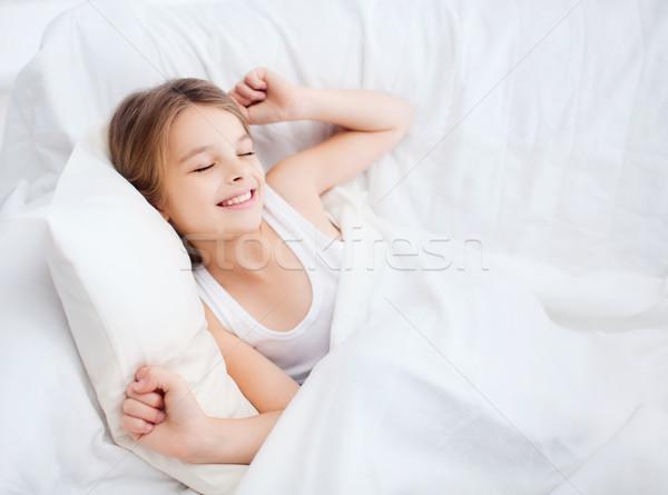 Sorridere ragazza bambino up letto home Foto d'archivio © dolgachov
