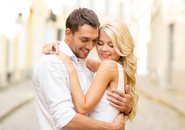 romantic happy couple hugging in the street Stock photo © dolgachov
