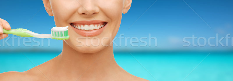 woman with toothbrush Stock photo © dolgachov