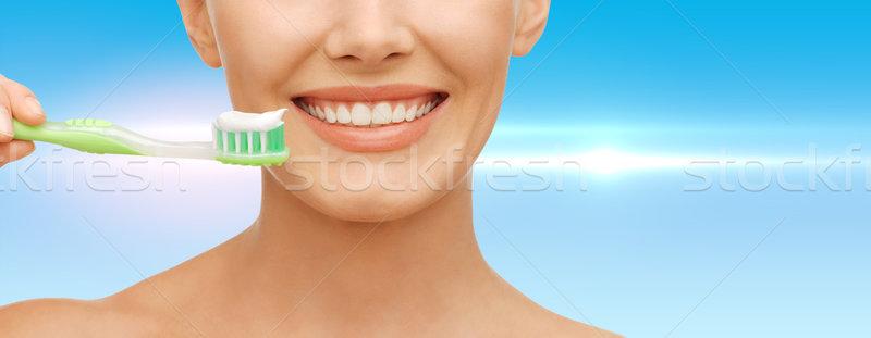 woman with toothbrush Stock photo © dolgachov