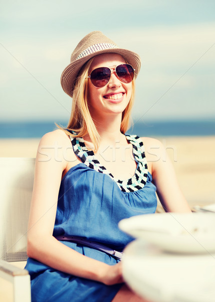 girl in shades in cafe on the beach Stock photo © dolgachov