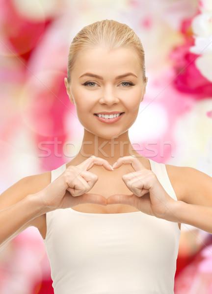 Foto d'archivio: Sorridere · a · forma · di · cuore · gesto · amore
