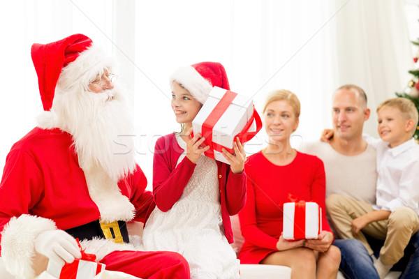 Gülen aile noel baba hediyeler ev tatil Stok fotoğraf © dolgachov