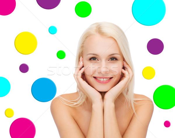 Gyönyörű fiatal nő pötty emberek szépség mosolyog Stock fotó © dolgachov