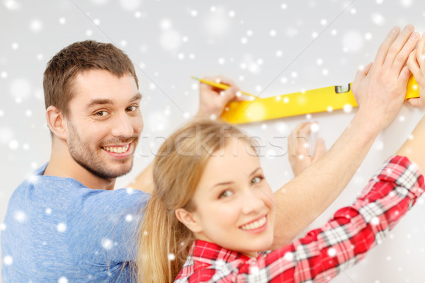 couple building using spirit level to measure Stock photo © dolgachov