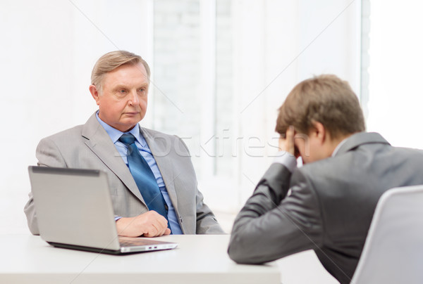 older man and young man having argument in office Stock photo © dolgachov