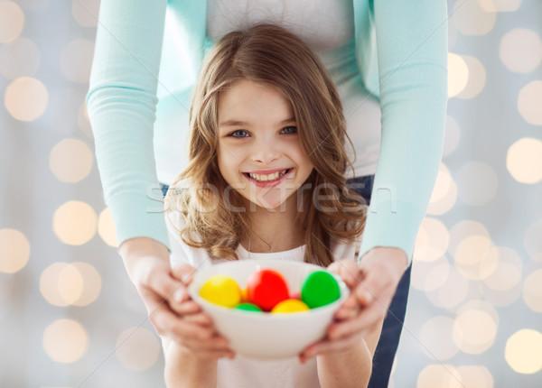 close up of happy family holding easter eggs Stock photo © dolgachov