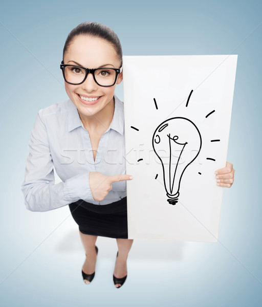 Mosolyog üzletasszony fehér tábla üzlet hirdetés szemüveg Stock fotó © dolgachov