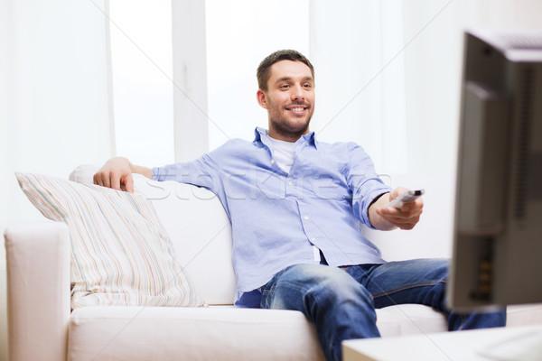 笑みを浮かべて 男 制御 ホーム 技術 ストックフォト © dolgachov