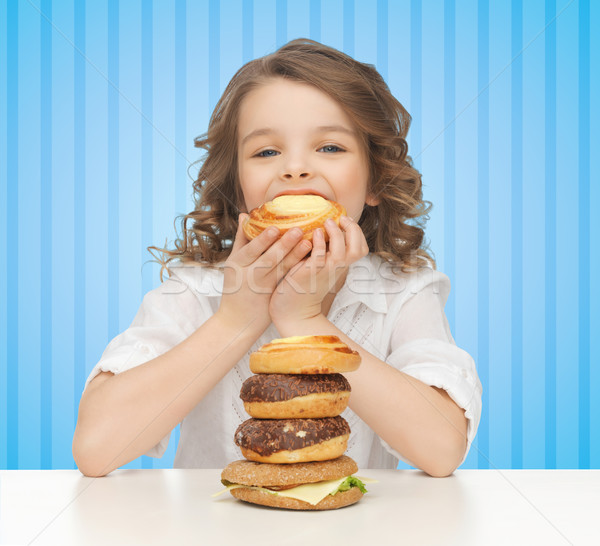 happy little girl eating junk food Stock photo © dolgachov