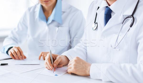 врач медсестры Дать рецепт бумаги фотография Сток-фото © dolgachov