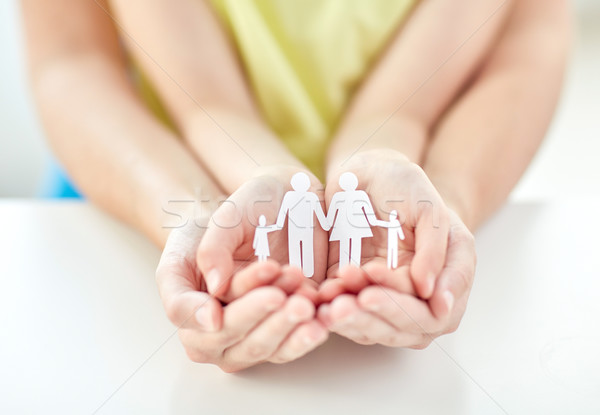 close up of woman and girl hands with paper family Stock photo © dolgachov