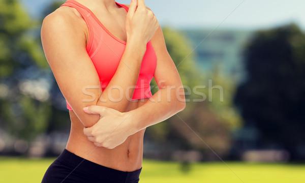 Sportos nő fájdalom könyök egészségügy fitnessz Stock fotó © dolgachov