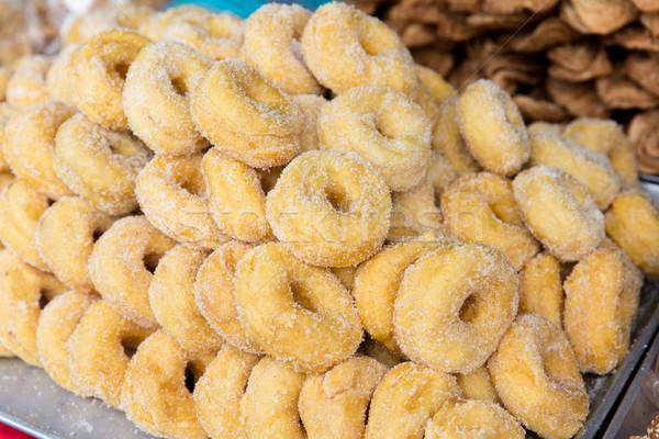 sugared donuts at asian street market Stock photo © dolgachov