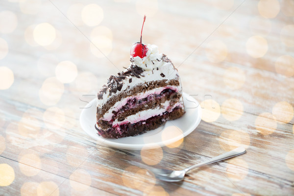 piece of cherry chocolate cake on wooden table Stock photo © dolgachov