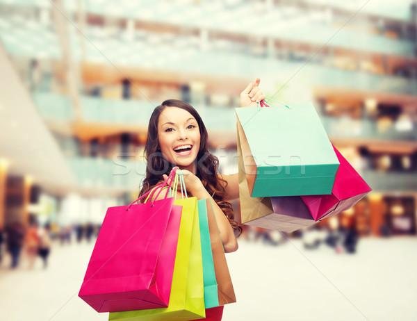 Gülümseyen kadın renkli satış hediyeler tatil Stok fotoğraf © dolgachov