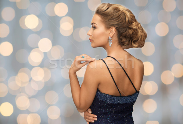 Bella donna diamante orecchino luci persone vacanze Foto d'archivio © dolgachov