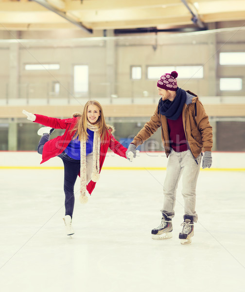 Stock photo: happy couple holding hands on skating rink
