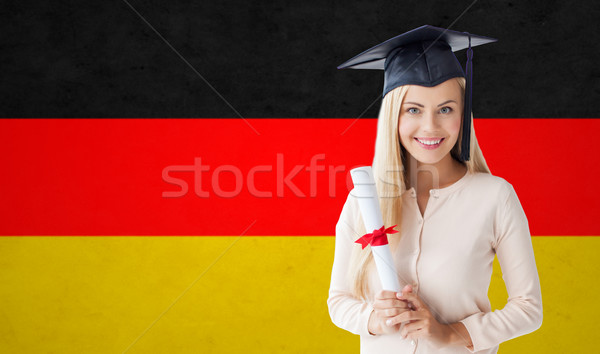 happy student girl in bachelor cap with diploma Stock photo © dolgachov