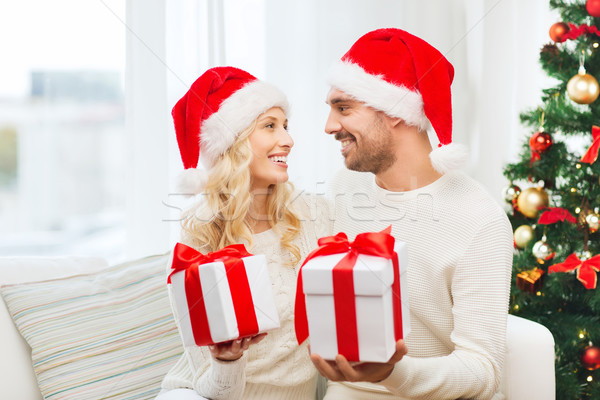happy couple at home exchanging christmas gifts Stock photo © dolgachov