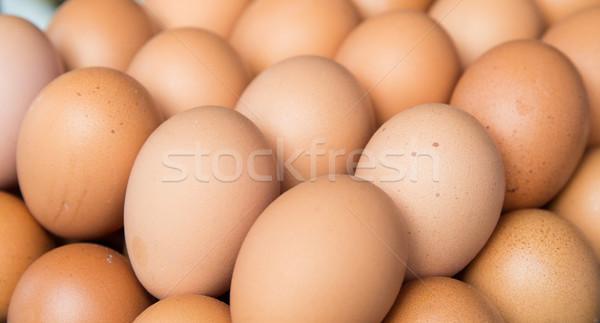 fresh eggs on tray at market Stock photo © dolgachov
