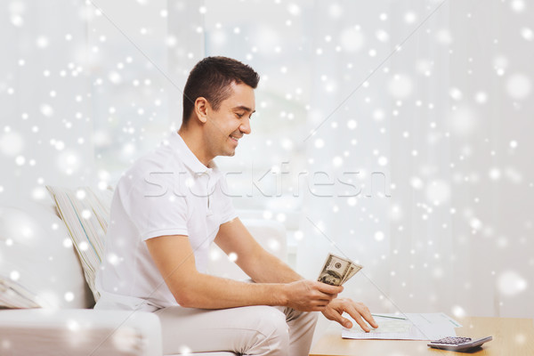man with papers and calculator counting money Stock photo © dolgachov