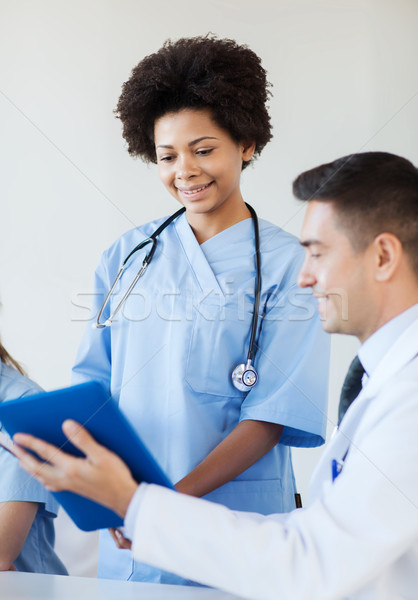 happy doctors meeting at hospital office Stock photo © dolgachov
