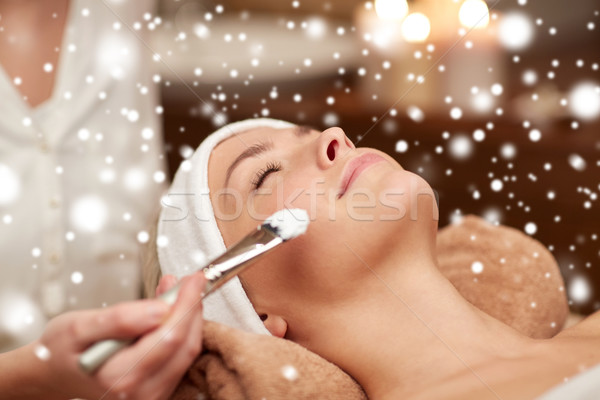 woman face and beautician applying mask in spa Stock photo © dolgachov