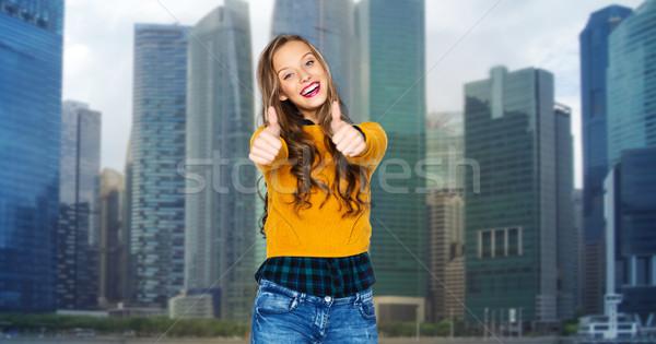 Gelukkig jonge vrouw tienermeisje tonen mensen Stockfoto © dolgachov