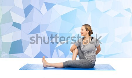 woman making yoga meditation in lotus pose on mat Stock photo © dolgachov