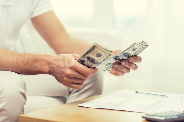 Közelkép férfi kezek pénz otthon megtakarított pénz Stock fotó © dolgachov