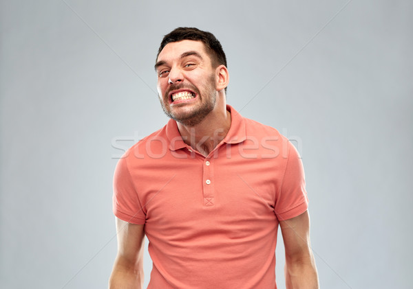 angry man over gray background Stock photo © dolgachov