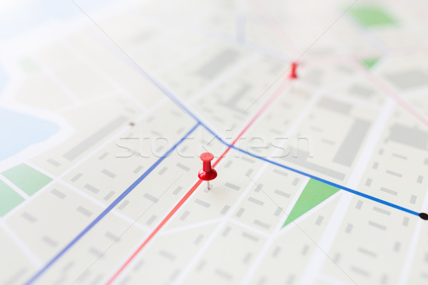 close up of map or city plan with pin Stock photo © dolgachov