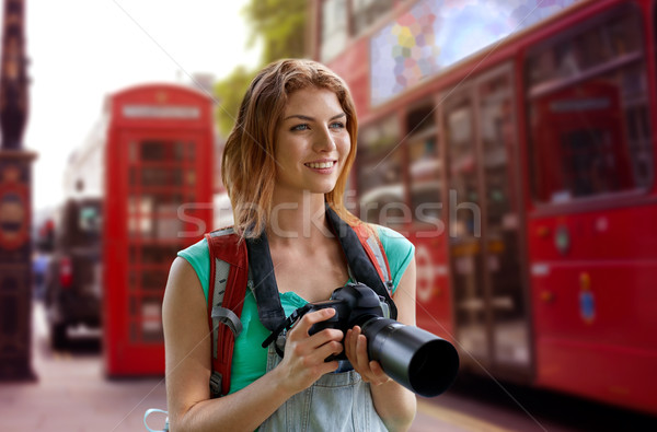 woman with backpack and camera over london city Stock photo © dolgachov