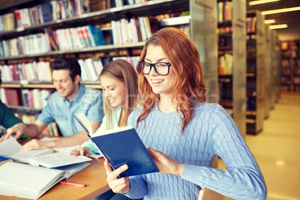 Diákok könyvek vizsga könyvtár emberek tudás Stock fotó © dolgachov