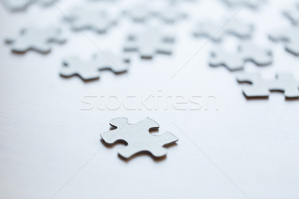 close up of puzzle pieces on table Stock photo © dolgachov