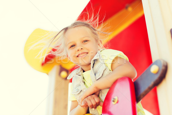 Szczęśliwy dziewczynka wspinaczki dzieci boisko lata Zdjęcia stock © dolgachov