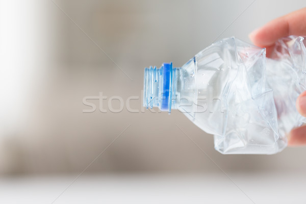 close up of hand holding used plastic bottle Stock photo © dolgachov
