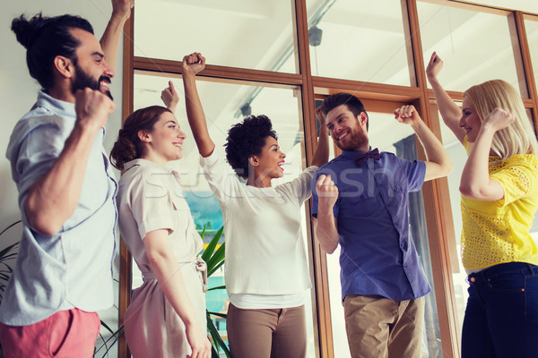happy creative team celebrating victory in office Stock photo © dolgachov