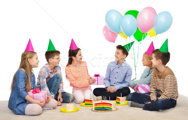 happy children giving presents at birthday party Stock photo © dolgachov