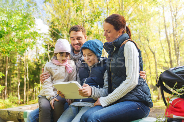 happy family with tablet pc and backpacks at camp Stock photo © dolgachov