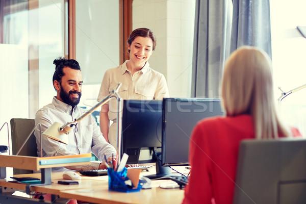 Felice creativo squadra computer ufficio business Foto d'archivio © dolgachov