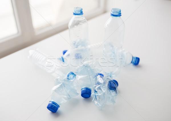 close up of empty used plastic bottles on table Stock photo © dolgachov