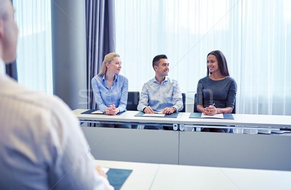 Gruppo sorridere riunione ufficio uomini d'affari Foto d'archivio © dolgachov