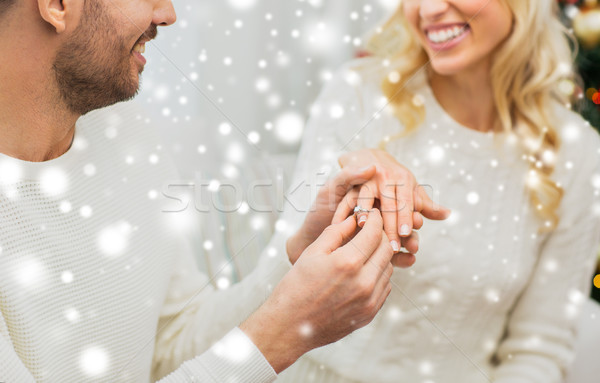 man giving diamond ring to woman for christmas Stock photo © dolgachov