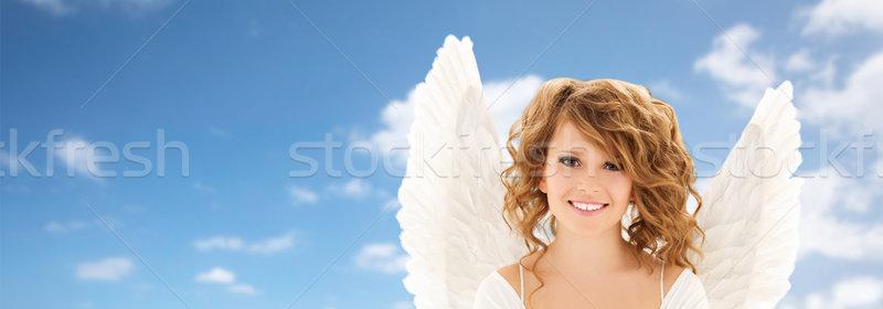 Feliz mulher jovem menina adolescente asas de anjo pessoas férias Foto stock © dolgachov