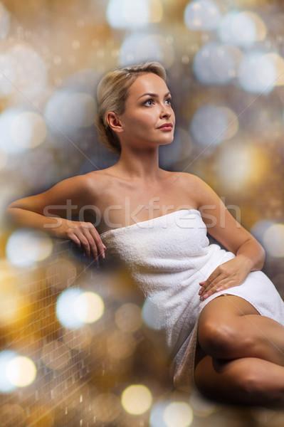 beautiful young woman sitting in bath towel Stock photo © dolgachov