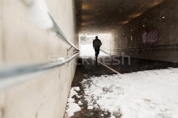 Férfi fut metró alagút tél fitnessz Stock fotó © dolgachov