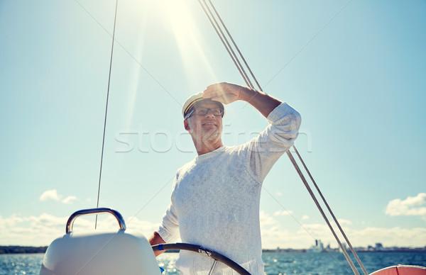 Idős férfi csónak jacht vitorlázik tenger Stock fotó © dolgachov