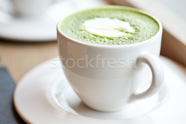 white cup of matcha green tea latte on table Stock photo © dolgachov